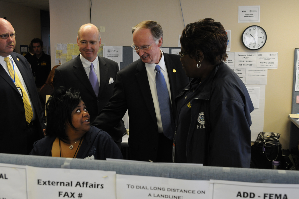 Severe Storm ^ Tornado - Birmingham, Ala. , May 20, 2011 -- On a tour of the FEMA/State Joint Field Office, Alabama Governor Robert Bentley greets Kala Nichols and Fannie Davis, FEMA External Affairs Resource Managers as Alabama Emergency Management Agency Director Art Faulkner (left), and Congressman Robert Aderholt (center) observe.  FEMA and the state are partners in providing recovery services to Alabama storm survivors.  George Armstrong/FEMA