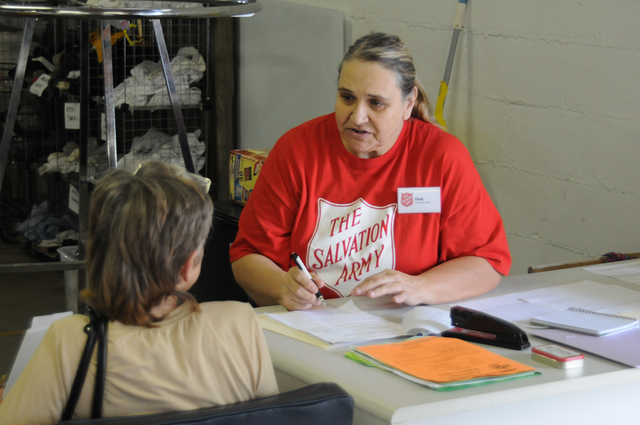 Severe Storm ^ Tornado - Jasper, Ala. , May 24, 2011 -- Salvation Army worker Deb Wilcutt interviews a storm survivor at the Salvation Army disaster relief distribution center which opened today. Recipients can receive a voucher for $300 which can then be redeemed at the center for emergency supplies.  FEMA and the Salvation Army are partners in helping survivors recover from the deadly April tornado.  George Armstrong/FEMA
