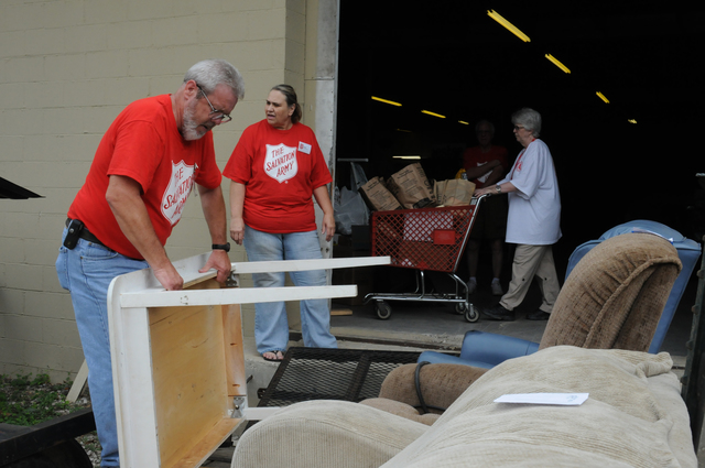 Severe Storm ^ Tornado - Jasper, Ala. , May 24, 2011 -- Salvation Army workers Terry NeSmith, Deb Wilcutt, and Myrtle Whitcomb distribute food and household goods to storm survivors at the Salvation Army disaster relief distribution center which opened today. Recipients can receive a voucher for $300 which can then be redeemed at the center for emergency supplies.  FEMA and the Salvation Army are partners in helping survivors recover from the deadly April tornado.  George Armstrong/FEMA