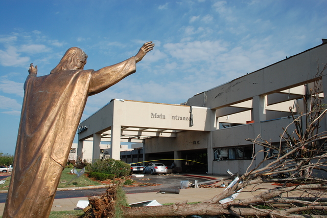 Tornado - Joplin, Mo. , May 24, 2011 -- A bronze state located in front of St. John's Regional Medical Center in Joplin was bent approximately 10 degrees but remains erect after sustaining 200 mph winds.  FEMA is only part of the emergency management team, which includes the public,federal, state, local and tribal partners, the business community and voluntary organizations in  Joplin to assist in the recovery process.  Jace Anderson/FEMA