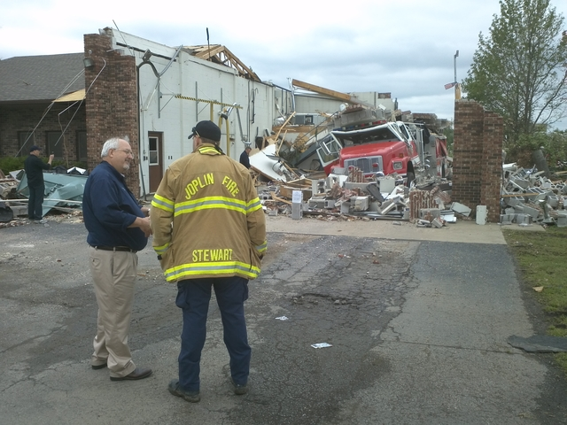 Tornado - Joplin, Mo. , May 26, 2011 -- Administrator Craig Fugate surveys a damaged fire station with a Joplin firefighter. FEMA is continuing to support disaster survivors and the community affected by the deadly tornado of May 22.