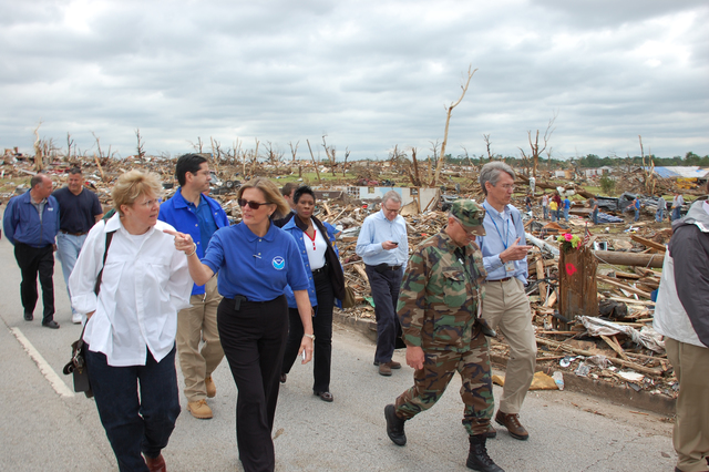 Tornado - Joplin, Mo. , May 26, 2011 -- U. S. Department of Homeland Security Deputy Secretary Jane Holl Lute (left) tours tornado damage with Kathy Sullivan, Assistant Secretary of the Department oF commerce/National Oceanic and Atmosphere Administration, in a neighborhood near St. John's Regional Medical Center.