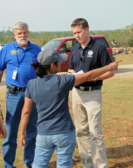 Tornado - Cashion, Okla. , May 27, 2011 -- FEMA's Brian Williams, and John R. Simmons of the U. S. Small Business Administration (SBA) speak with a tornado survivor during a Preliminary Damage Assessment. FEMA/Earl Armstrong.
