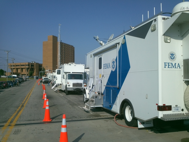 Tornado - Joplin, Mo. , May 29, 2011 -- A Mobile Emergency Response Support vehicle in Joplin, Mo.  Each MERS vehicle is equipped with telephone and computer capabilities, providing a mobile workspace for FEMA personnel.