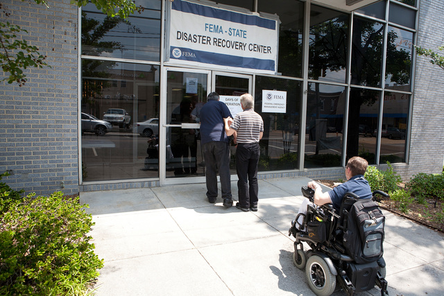 Severe Storm ^ Tornado - Collegedale, Tenn. , May 31, 2011 -- Coy Carl, left, assists James Fleming, DOC, into the Cleveland Disaster Recovery Center, followed by Pam Jackson from the Chattanooga Independent Living Center.  FEMA goes to great lengths to ensure that special needs survivors receive the benefits they are entitled to. Photo by Ed Edahl/FEMA