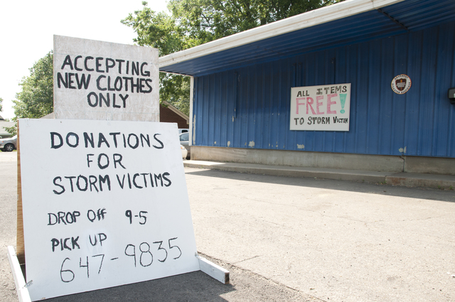 Tornado - Clarksville, Ark. , June 1, 2011 -- A sign in front of a makeshift donation center in  Louisville, AR alerts individuals to the site where they can donate or obtain items needed. Tornadoes ripped through NW Arkansas in the early morning hours of May 25, 2011.  Photo by Patsy Lynch/FEMA