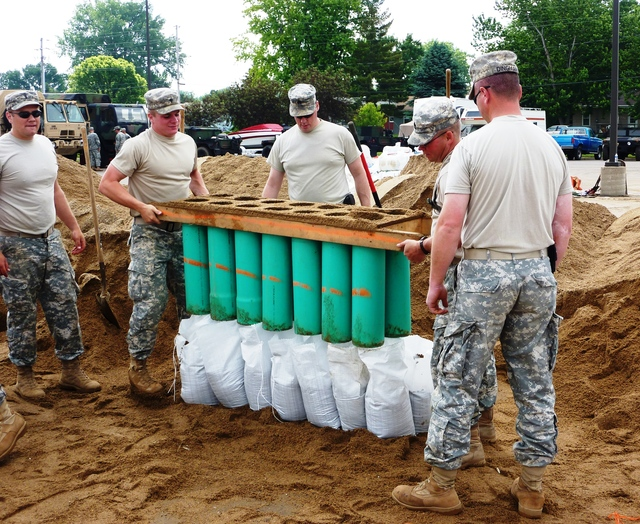 Flooding - North Sioux City, S. D. , June 11, 2011 -- Members of U. S. Army National Guard 139th Support Brigade fill sandbags at the Dakota Valley High School staging area in North Sioux City, S. D. FEMA and other federal agencies are supporting the State Incident Management Team in their effort to prepare for flooding along the Missouri River.
