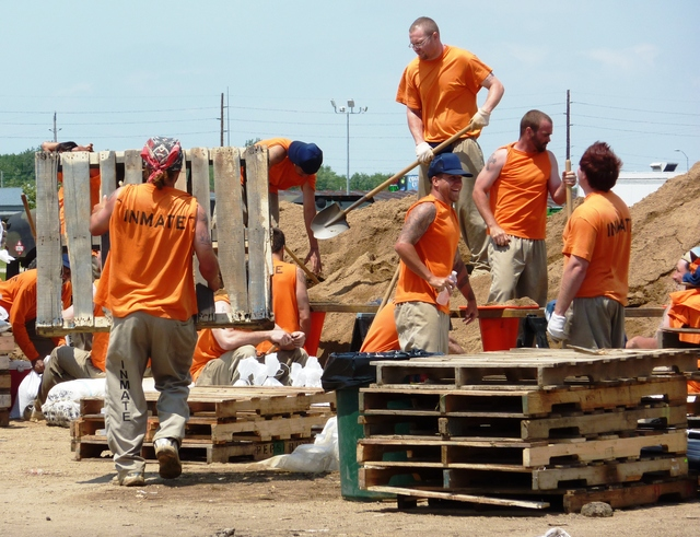 Flooding - North Sioux City, S. D. , June 12, 2011 -- These inmates from the S. D. Department of Corrections are filling sandbags to be used by residents in an effort to protect their homes from flooding from the Missouri River. FEMA and other federal agencies are supporting the State Incident Management Team in their effort to respond to the flooding.