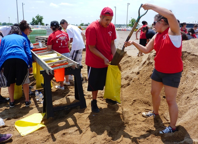 Flooding - North Sioux City, S. D. , June 12, 2011 -- These Upward Bound students from Rosebud and Pine Ridge, SD communities are filling sandbags for residents to use in an effort to prevent damage from  along the Missouri River. FEMA and other federal agencies are supporting the State Incident Management Team in their effort to respond to the flooding.