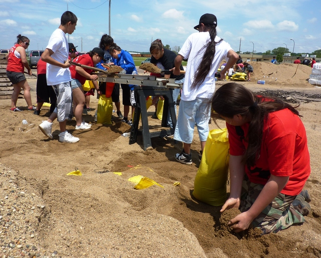Flooding - North Sioux City, S. D. , June 12, 2011 -- These Upward Bound students from Rosebud and Pine Ridge, S. D. communities are filling sandbags for residents to use to help prevent damage from flooding along the Missouri River. FEMA and other federal agencies are supporting the State Incident Management Team in their effort to respond to the flooding.