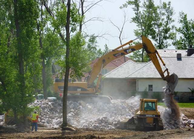 Flooding - North Sioux City, S. D. , June 16, 2011 -- This heavy equipment is moving rip rap needed to repair erosion of the levee at Dakota Dunes on the Missouri River. FEMA and other federal agencies are supporting the State Incident Management Team in their effort to prepare for flooding along the river.
