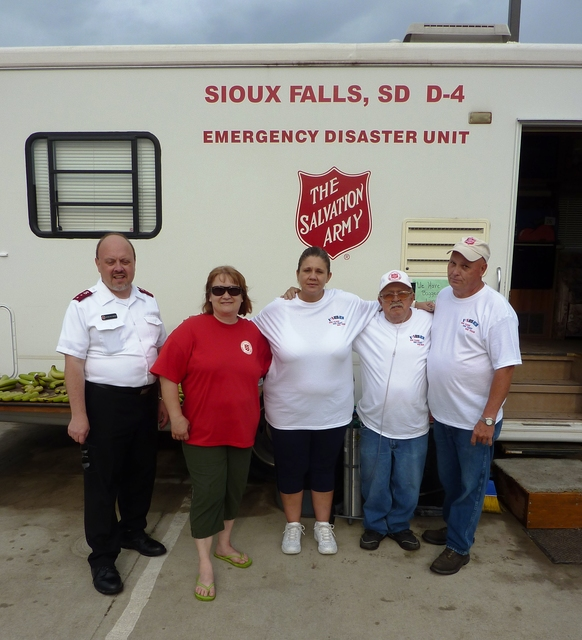 Flooding - North Sioux City, S. D. , June 17, 2011 -- Capt. Von Vandiver (left) and his Salvation Army crew from Sioux City, IA, take a break from serving food and beverages to members of the S. D. Incident Management Assistance Team in Dakota Dunes.  FEMA and other federal agencies are supporting the State Incident Management Team in their effort to respond to flooding along the Missouri River.