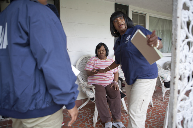 Severe Storm ^ Tornado - Chattanooga, Tenn. , June 18, 2011 -- Teisha Jeter (right), a community relations field worker, discusses special needs assistance with Delores Smith, who is visually impaired, as Joyce Morgan, her community relations team mate, looks on. Community relations field workers help special needs survivors find the help they may be eligible for.  Photo by Ed Edahl/FEMA.
