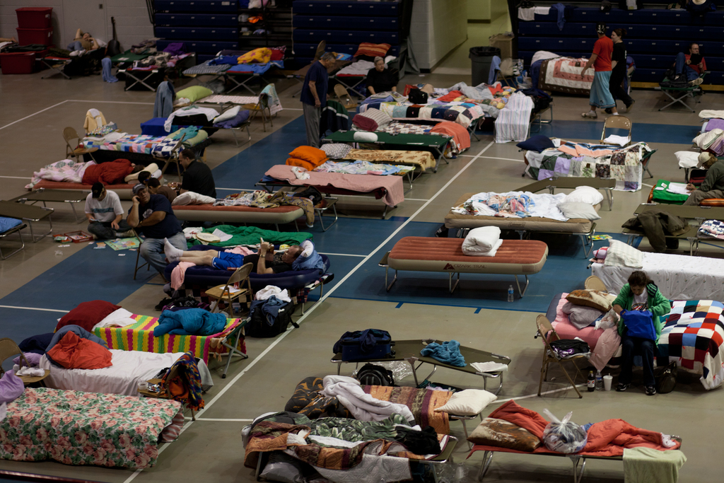 Flooding - Minot, N. D. , June 24, 2011 -- Red Cross shelter in an auditorium that is housing flood evacuees.  Burleigh and Ward counties were designated a federal disaster area, opening the way for federal disaster assistance from FEMA.  Andrea Booher/FEMA
