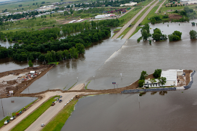 Flooding - Minot, N. D. , June 25, 2011 -- Aerial view of Highway 2, east of Minot closed due to flooding from the Souris River. FEMA is providing assistance through the Public Assistance program to Ward and Burleigh counties.  Andrea Booher/FEMA
