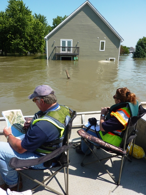 Flooding - North Sioux City, S. D. , June 29, 2011 -- This preliminary damage assessment team in Union County, S. D. travels by boat to assess damage to homes caused by the flooded Missouri River. FEMA and other federal agencies are supporting the State Incident Management Team in their effort to respond to the flooding.