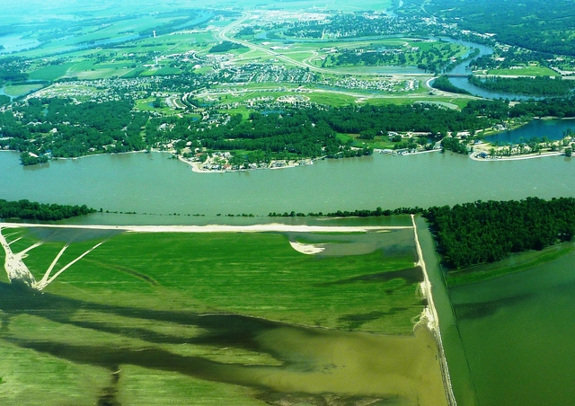 Flooding - North Sioux City, S. D. , July 1, 2011 -- This aerial view of the Missouri River shows the white line of sandbags enclosing North Sioux City, SD and flooded Nebraska farmland in the foreground. FEMA and other federal agencies are supporting the State Incident Management Team in their effort to prepare for flooding along the river.