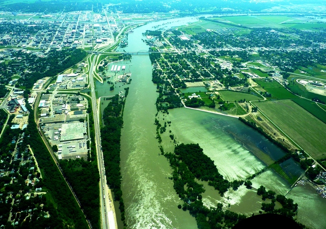 Flooding - Sioux City, Iowa, July 1, 2011 -- This aerial view shows the swollen Missouri River inundating Sioux City, IA (left) and South Sioux City, NE (right).