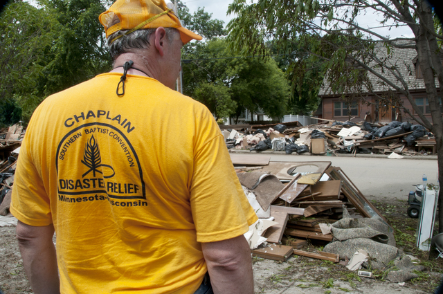 Flooding - Minot, N. D. , July 18, 2011 -- A volunteer from the Southern Baptist Convention Disaster Response team takes a break from cleaning a home in Minot, ND neighborhood that was flooded when the  Souris or Mouse River overflowed its' banks. The Baptist Disaster Response teams are one of many volunteer organizations in Minot helping with the clean up efforts. Photo by Patsy Lynch/FEMA