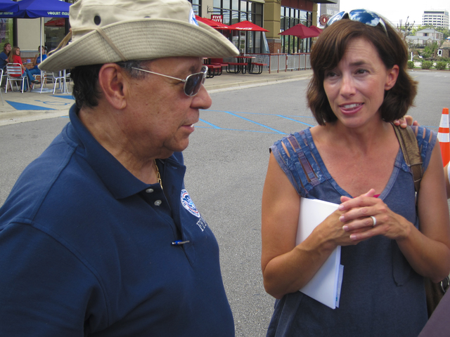 Tornado - Tuscaloosa, Ala. , July 18, 2011 -- Disaster survivior Jennifer Wilson discusses the importance of safe rooms with FEMA Mitigation Advisor David Curbelo at a FEMA Mitigation Outreach Workshop hosted by WTXT and ZBQ Radio in front of Starbucks, Midtown Village Mall, 1800 McFarland Blvd. , Tuscaloosa. Photo by Christopher Mardorf / FEMA.