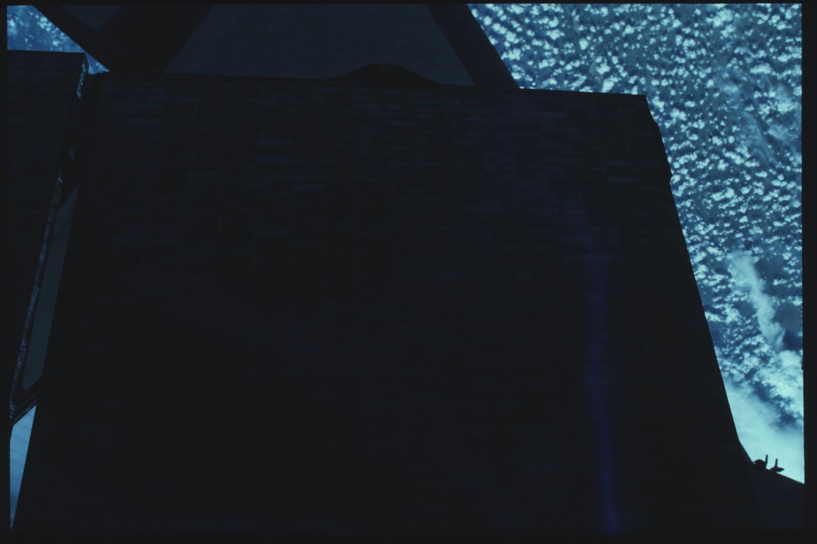 41C-22-941 - STS-41C - EVA to repair the SMM satellite