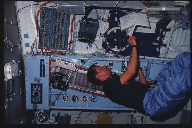 41D-06-012 - STS-41D - Walker works with CFES experiment