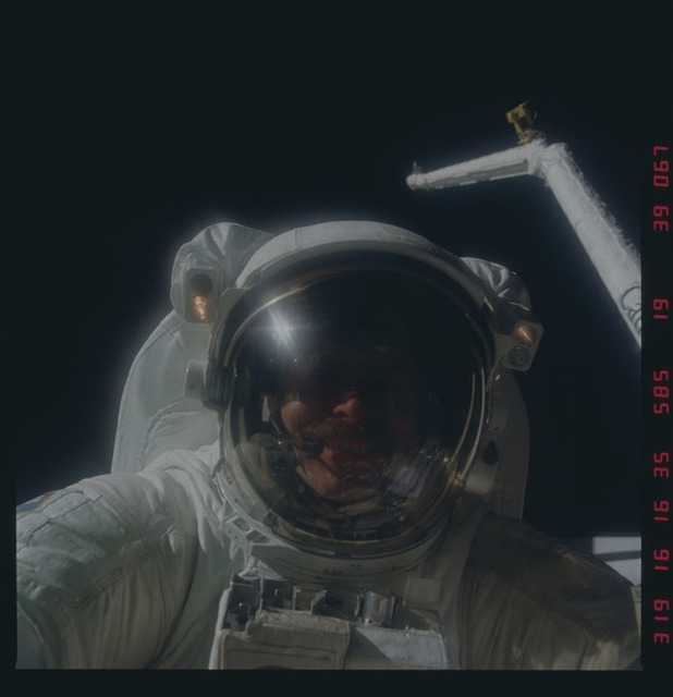 51A-39-067 - STS-51A - 51A crewmember recovering satellites - PICRYL