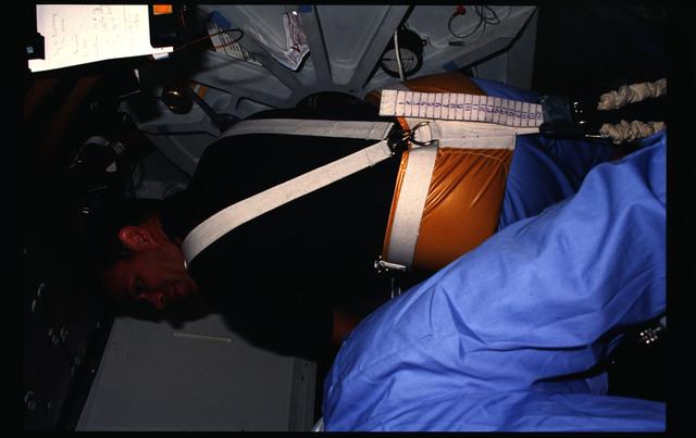 51B-05-015 - STS-51B - Crewmember on treadmill