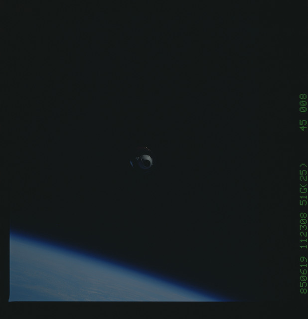 51G-45-008 - STS-51G - Telestar Satellite drifting in space