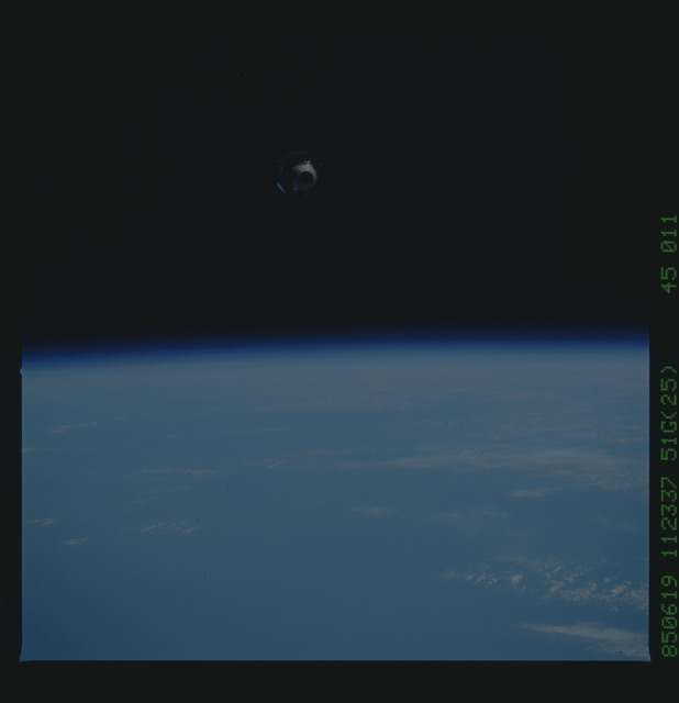 51G-45-011 - STS-51G - Telestar Satellite drifting in space