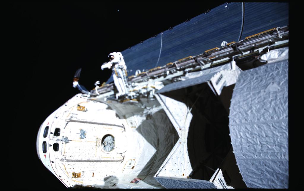 51I-102-055 - STS-51I - Payload bay during Fisher and van Hoften EVA