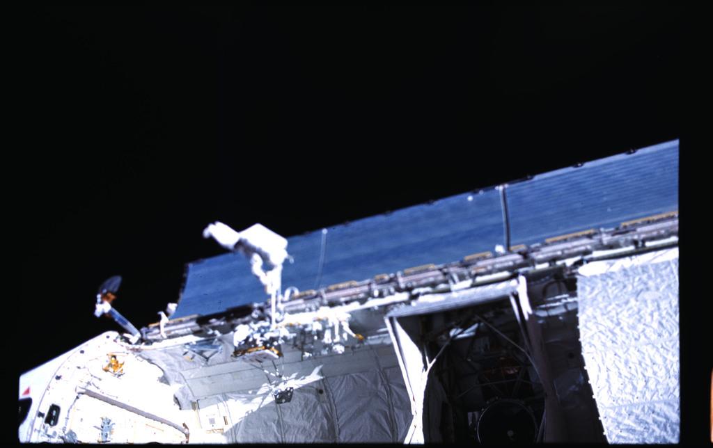 51I-102-057 - STS-51I - Payload bay during Fisher and van Hoften EVA