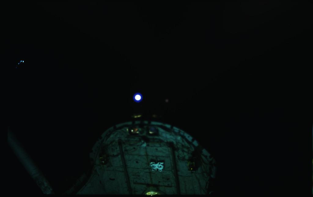 51I-102-061 - STS-51I - Payload bay during Fisher and van Hoften EVA