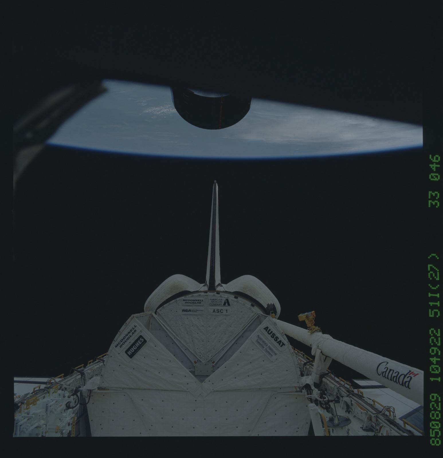 51I-33-046 - STS-51I - Syncom-IV communication satellite deploys from payload bay