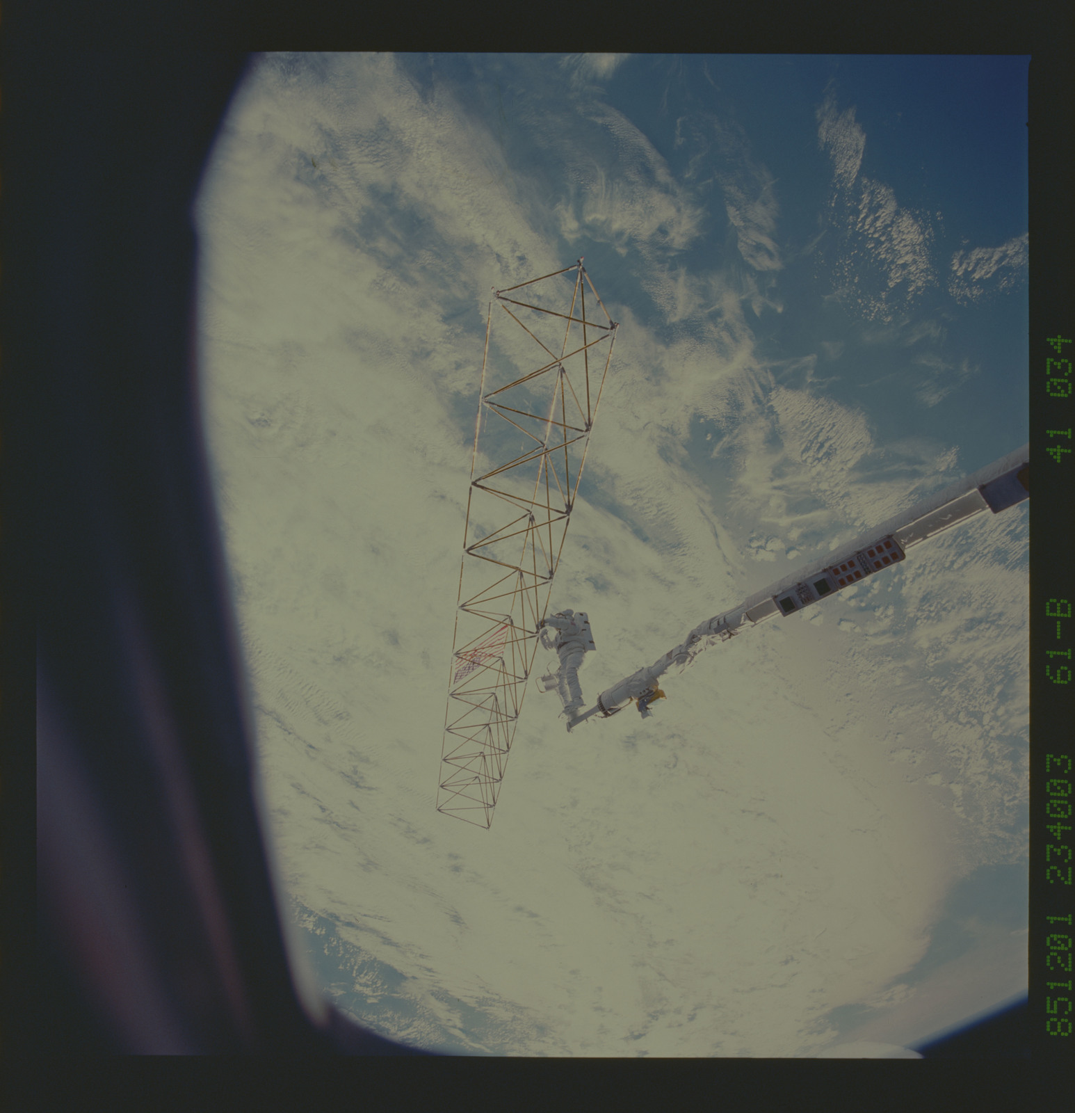 61B-41-034 - STS-61B - Ross and Spring work on EASE and ACCESS during Extravehicular Activity (EVA)