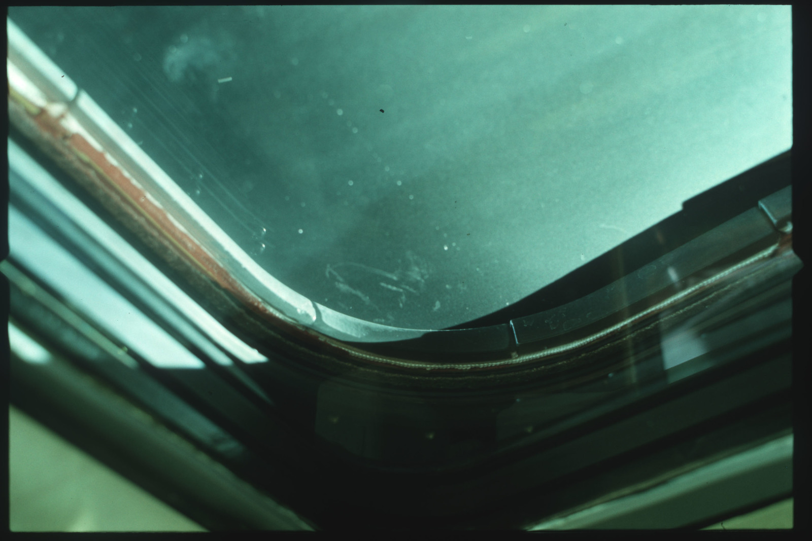S01-07-507 - STS-001 - Crew compartment flight deck window debris,damage,streak documentation