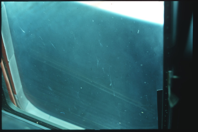 S01-07-524 - STS-001 - Crew compartment flight deck window debris,damage,streak documentation