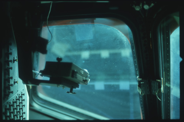 S01-07-528 - STS-001 - Crew compartment flight deck window debris,damage,streak documentation