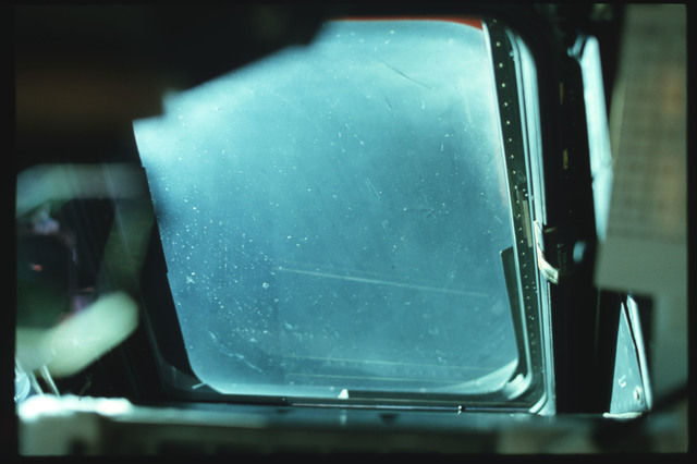 S02-02-846 - STS-002 - Crew compartment forward flight deck window debris and damage documentation