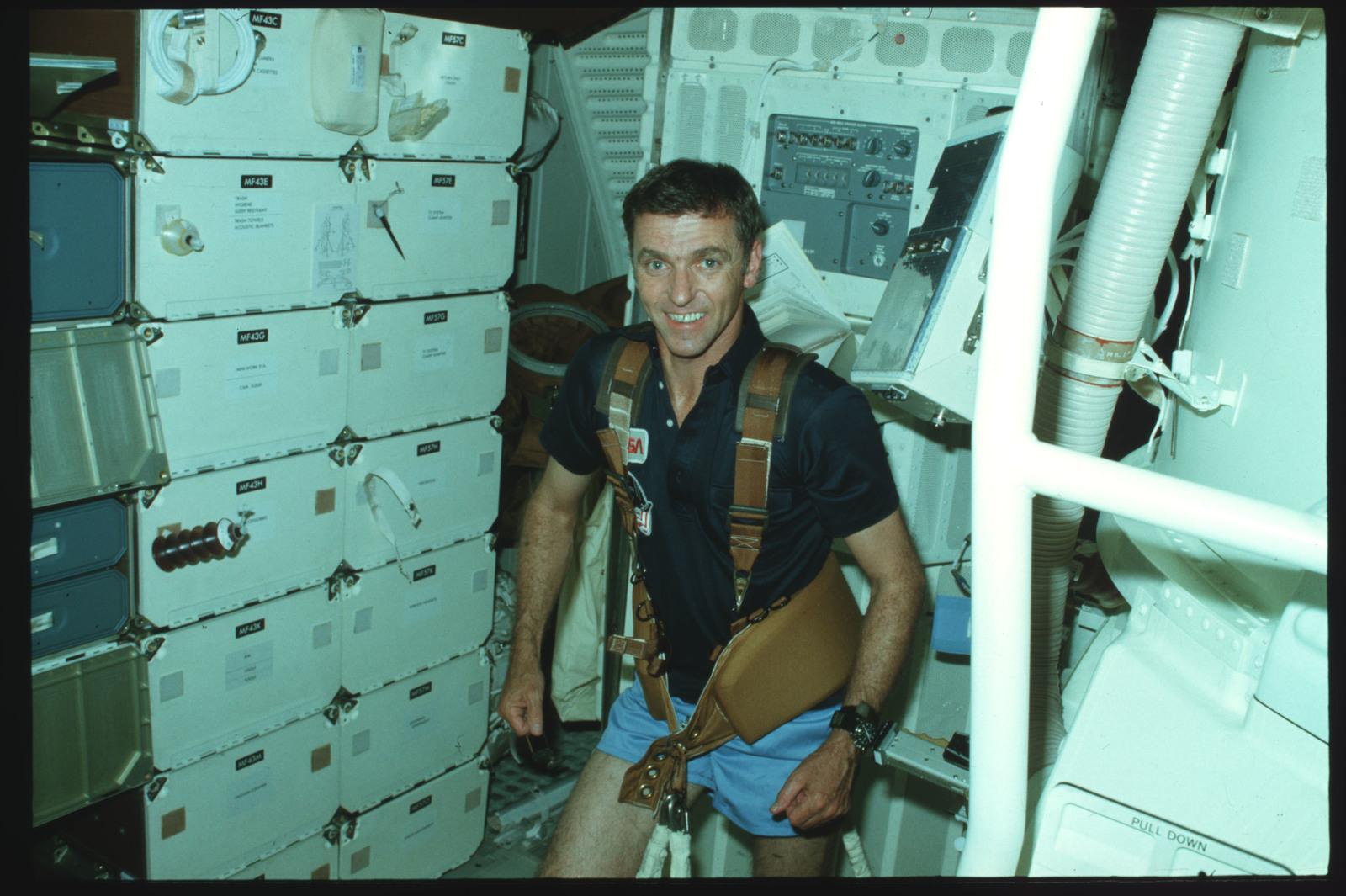 S02-02-880 - STS-002 - Commander Engle exercises on middeck using exerciser restraint harness