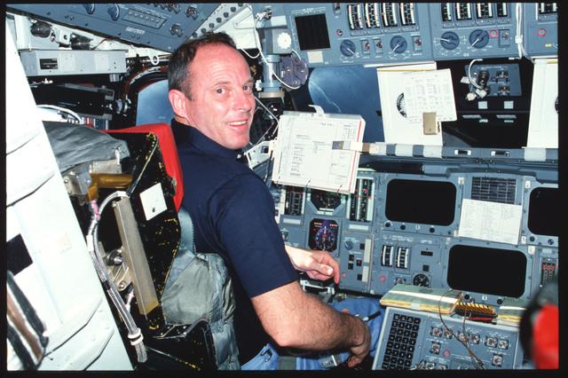 S03-19-004 - STS-003 - Commander Lousma reviews FDF procedures on forward flight deck