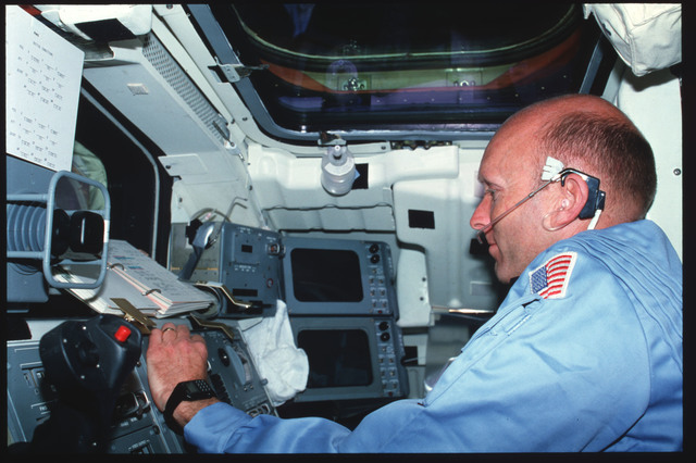 S03-19-019 - STS-003 - Pilot Fullerton reviews checklist on Aft Flight Deck Onorbit Station