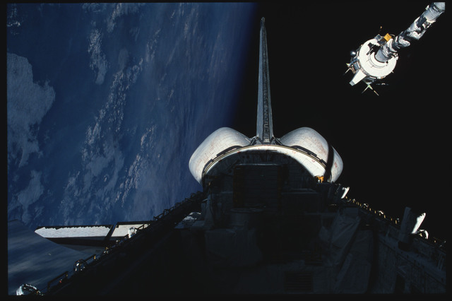 S03-21-105 - STS-003 - PDP grappled by RMS is maneuvered above payload bay then restowed on pallet