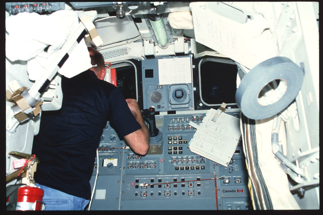 S03-24-210 - STS-003 - Pilot Fullerton works at aft flight deck onorbit station window W9