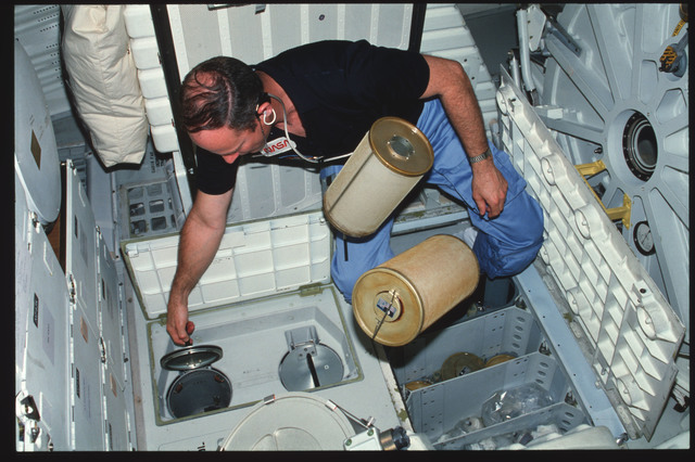S03-25-235 - STS-003 - Commander Lousma replaces ARS LiOH canisters on middeck