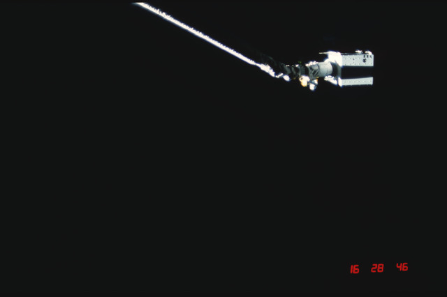 S04-20-023 - STS-004 - IECM grappled by RMS and positioned above payload bay
