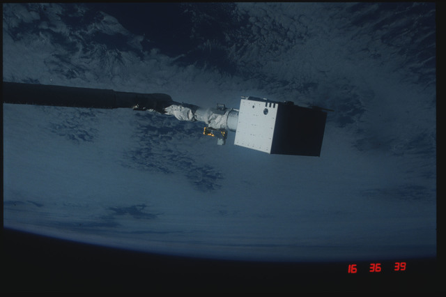 S04-20-024 - STS-004 - IECM grappled by RMS and positioned above payload bay