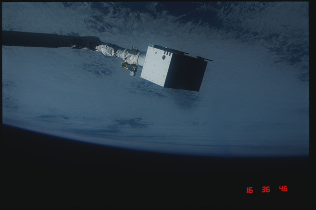 S04-20-025 - STS-004 - IECM grappled by RMS and positioned above payload bay