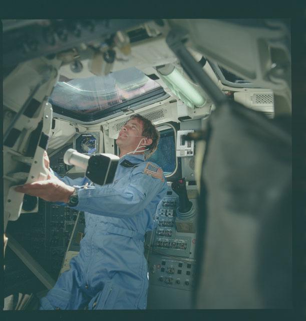 S05-38-966 - STS-005 - Astronaut Lenoir on aft flight deck during SBS-3 deploy