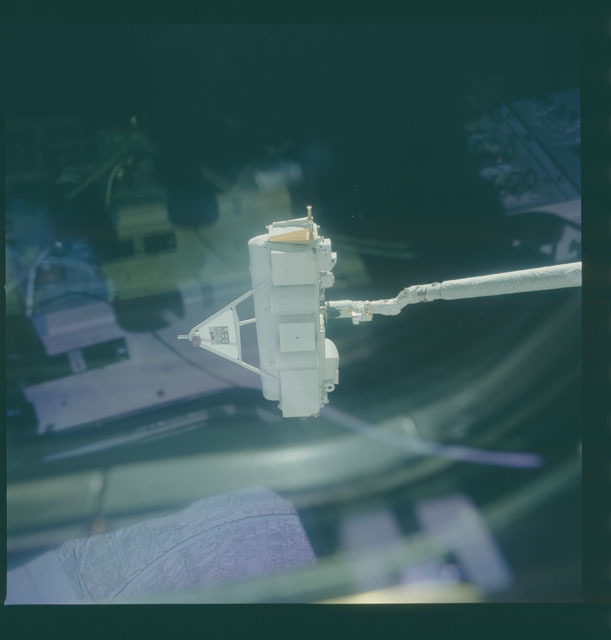 S07-03-125 - STS-007 - Challenger's RMS arm grasps SPAS-01 during proximity operations